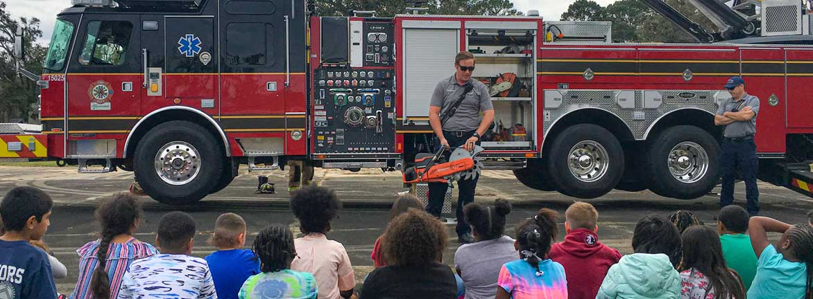 Firefighter teaching kids